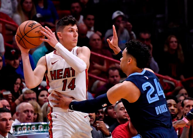 Heat guard Tyler Herro (14) is guarded by Memphis Grizzlies guard Dillon Brooks (24) during the first half at American Airlines Arena in Miami on Wednesday, Oct. 23, 2019.