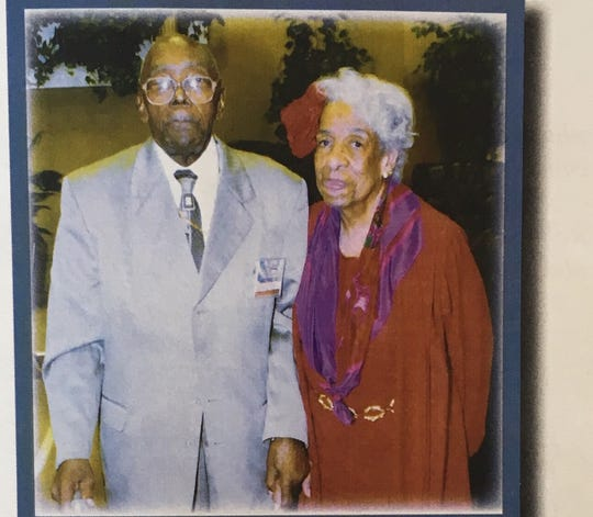 Bishop Albert Reed and Pauline Reed pose for a photo.