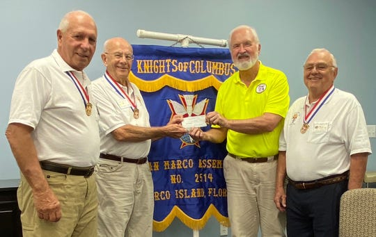 Joe Swaja, presented Collier Lee Honor Flight representative Captain Frank Reifsnyder, with a check for $2,000. From left, John DeRosa, Swaja, Reifsnyder and John Fusco.