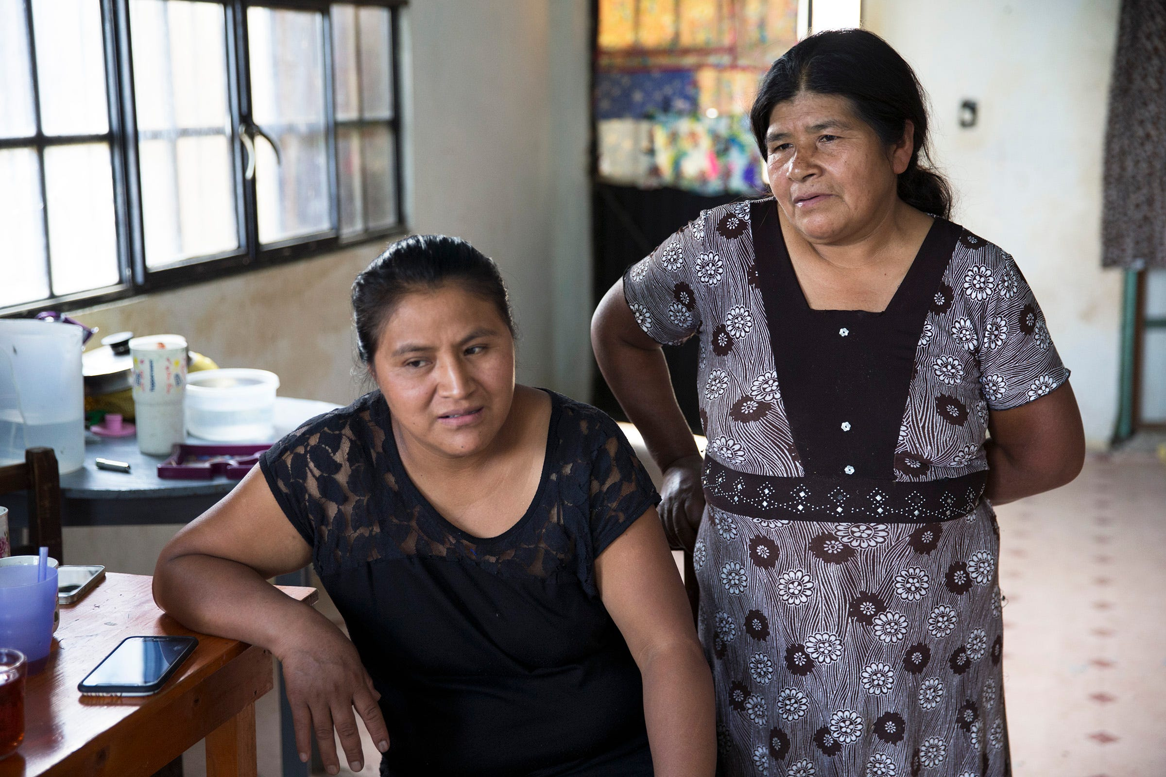 Roberto Tecpile's wife, Verónica Montalvo, and his mother, Concepciona Acahua, in the home that Tecpile's family is building in Astacinga, México, thanks to his work at  a Wisconsin dairy farm.