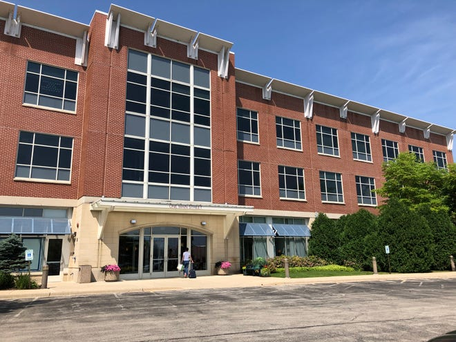 """Foxconn Technology Group has received a building permit to remodel a small part of a building at 1 Main St., Racine, that the company has said will house one of what Foxconn calls its """"innovation centers."""" The firm has been slow to develop the centers it has announced for Milwaukee, Green Bay and Eau Claire as well as Racine."""