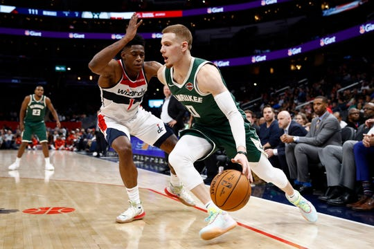 The Bucks picked up the third-year option on guard Donte DiVencenzo's contract on Thursday.