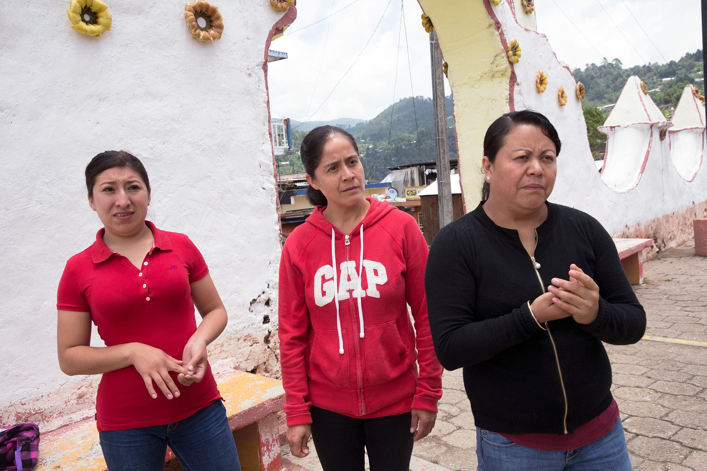 Blanca Hernández, center, walks with friends Lucero Quechulpa, left, and Fátima Anastasio in Texhuacán. The three worked at dairy farms in Wisconsin or Minnesota before returning to México.