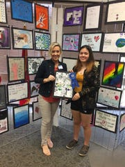 Jodi Leeker (left) presents the first-place award from Baxter Regional's annual Project Semicolon Art Contest to Layla Biby of Gainesville, Mo., High School.