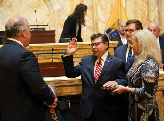 With his wife and son at his side, District 25 Assemblyman Anthony M. Bucco is officially sworn in on New Jersey Senate floor to succeed his late father, Anthony R. Bucco, who died on Sept. 16. Oct. 24, 2019.