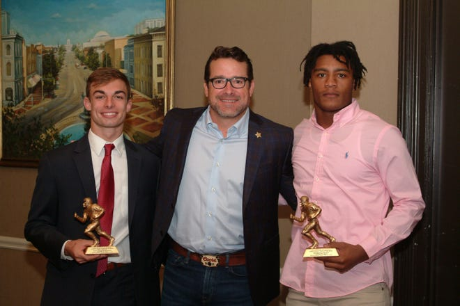 From left, Trinity Presbyterian's Tate Holley, ESPN college football analyst Tom Luginbill, a featured speaker at the Montgomery Quarterback Club and Tallassee High School's Tavarious Griffin.