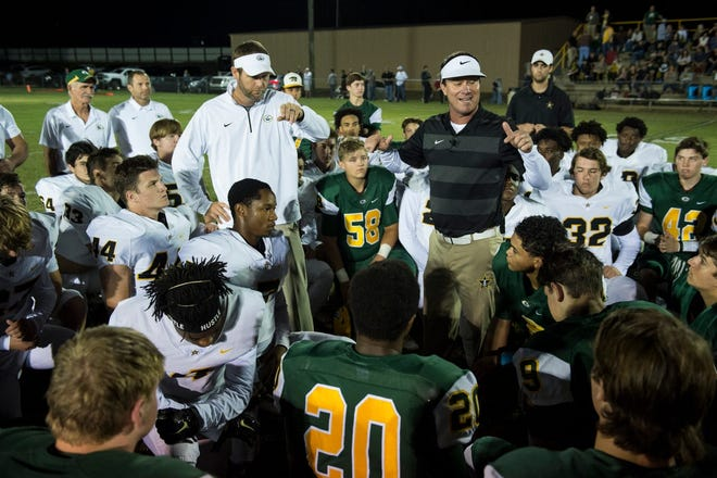 Autauga Academy head coach Bobby Carr and Edgewood head coach Darryl Free address both teams together before praying together before the game at Autauga Academy on Thursday, Oct. 18, 2018.