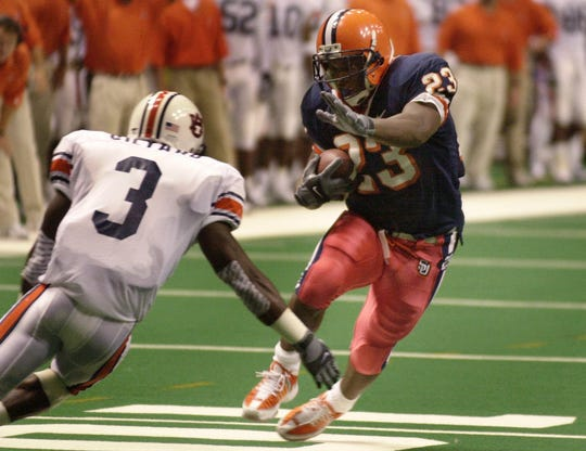 Syracuse running back James Mungro (23) tries to move past Auburn's Roshard Gilyard (3) in Syracuse, N.Y., Saturday, Sept. 22, 2001.