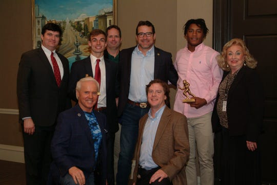 Standing from left are Montgomery Quarterback Club board member Ben Venable, player of the week Tate Holley of Trinity Presbyterian School, board member Brett Scott, ESPN's Tom Luginbill, player of the week Tavarious Griffin of Tallahassee High School and board member Rebecca Williams.  Kneeling from left are MQC board members Perry Hooper, Jr., and Kendall Leverette.