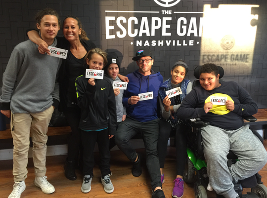 Truett McKeehan is on the far left in this 2015 picture with his siblings and his parents after participating in The Escape Game. From left to right, Truett, his mother, Amanda, his siblings Leo and Judah, his father, Christian rapper TobyMac, and siblings Marlee and Moses.