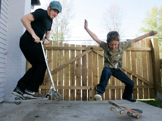 Toby McKeehan, professionally known as Christian artist TobyMac, plays with is son Truett, 8, in the backyard of their Franklin, Tenn. home on April 16, 2007.