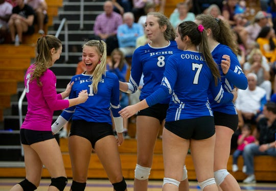 Barron Collier High School celebrates after scoring a point against Mourning High School from North Miami in the Class 6A regional volleyball quarterfinals game, Wednesday, Oct. 23, 2019, at Barron Collier High School.