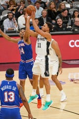 Oct 23, 2019; San Antonio, TX, USA; San Antonio Spurs guard Bryn Forbes (11) shoots the ball past New York Knicks guard Allonzo Trier (14) during the first half at the AT&T Center.