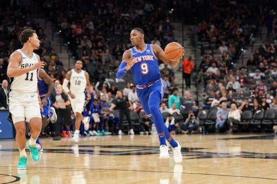 Oct 23, 2019; San Antonio, TX, USA; New York Knicks forward RJ Barrett (9) dribbles in against San Antonio Spurs guard Bryn Forbes (11) during the second half at the AT&T Center.