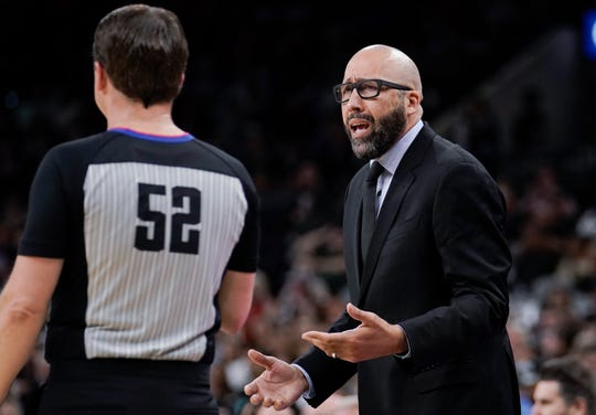 New York Knicks coach David Fizdale, right, talks to referee Scott Twardoski during the first half of the team's NBA basketball game against the San Antonio Spurs, Wednesday, Oct. 23, 2019, in San Antonio. San Antonio won 120-111.