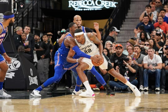Oct 23, 2019; San Antonio, TX, USA; San Antonio Spurs forward Rudy Gay (22) drives in against New York Knicks forward RJ Barrett (9) during the second half at the AT&T Center.