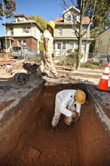 Workers from Montana Construction, Janusz Plonski, digs the ground as he and other workers do lead pipe replacement along Pomona Avenue in Newark on 10/24/19.