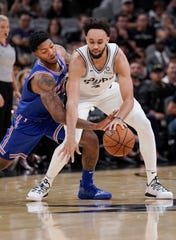 San Antonio Spurs' Derrick White, right, is fouled by New York Knicks' Elfrid Payton during the first half of an NBA basketball game Wednesday, Oct. 23, 2019, in San Antonio.