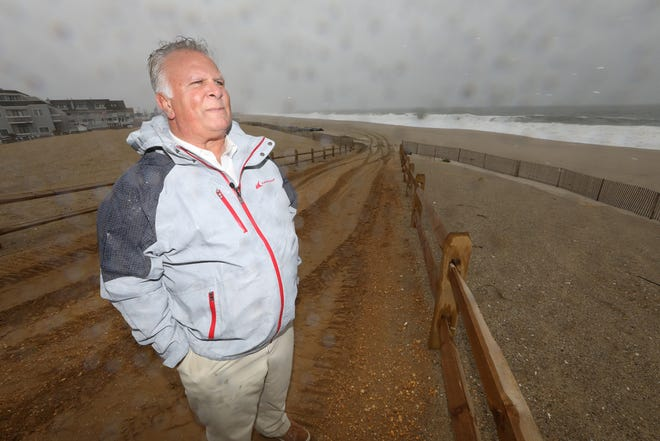 Point Pleasant Mayor Stephen Reid on the beach where 18-22 foot dunes have been built  to protect the boardwalk from a rising ocean.
