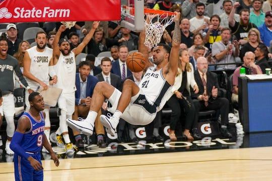 Oct 23, 2019; San Antonio, TX, USA; San Antonio Spurs forward Trey Lyles (41) dunks the ball in front of New York Knicks forward RJ Barrett (9) at the AT&T Center.