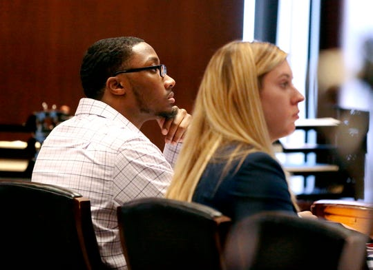 In this Wednesday, Oct. 23, 2019 photo, defendant Khalil Wheeler-Weaver listens to opening arguments during his triple murder trial in Newark, N.J. Wheeler-Weaver is charged with strangling and asphyxiating three women in the fall of 2016. He's also accused in the attempted murder of a fourth woman.