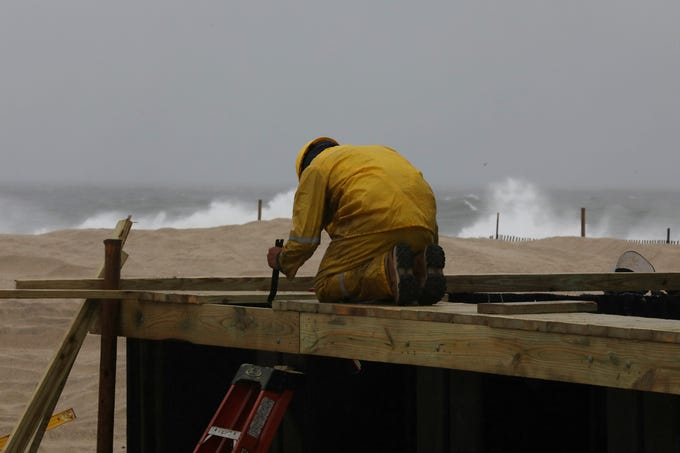 A project in Point Pleasant consisting of a steel wall covered by wood is built to protect the boardwalk from a possible tide that can can cause flooding due to climate change.