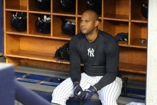 Oct 17, 2019; Bronx, NY, USA; New York Yankees center fielder Aaron Hicks (31) sits on the bat rack in the dugout during batting practice before game four of the 2019 ALCS playoff baseball series against the Houston Astros at Yankee Stadium.