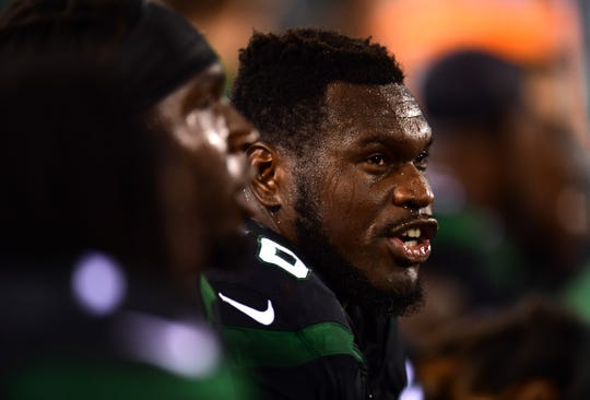 Kelechi Osemele #70 of the New York Jets sits on the sidelines during their game against the Cleveland Browns at MetLife Stadium on September 16, 2019 in East Rutherford, New Jersey.