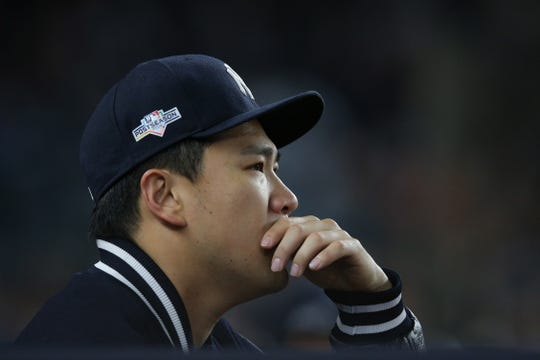 Oct 17, 2019; Bronx, NY, USA;  New York Yankees starting pitcher Masahiro Tanaka (19) reacts after being removed from the game during the sixth inning against the Houston Astros in game four of the 2019 ALCS playoff baseball series at Yankee Stadium.
