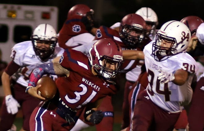 Senior all-purpose back Jesse Varela (31)  helps move the chains for the Deming High Wildcats.