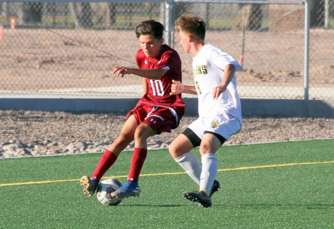 Freshman Wildcat Alfonso Quintana (10) pushes the ball up during Tuesday's District 3-5A soccer match against Mayfield High. The Trojans escaped with a 1-0 victory.