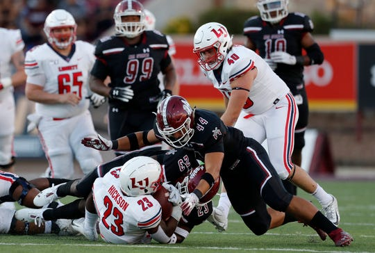 Former Oñate standout Matt Young has earned his way onto the field as a starting linebacker at New Mexico State.