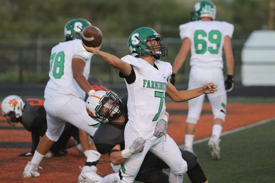Farmington quarterback Caleb Carrillo, seen here during a non-district football game on Friday, Sept. 13 at Aztec, is the Daily Times October athlete of the month.