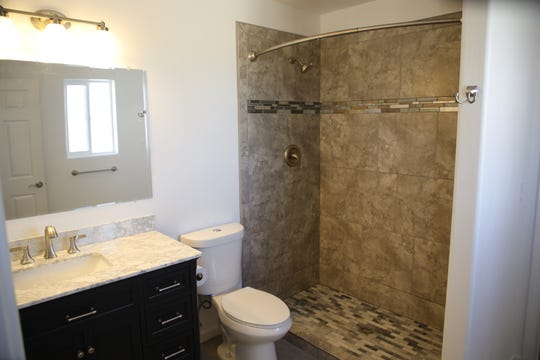 A walk-in shower with decorative tile is the highlight of the master bathroom in the Tres Rios Habitat for Humanity-built home on Crouch Mesa.
