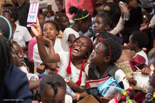 Children in Zambia show their joy at receiving the Christmas gifts.
