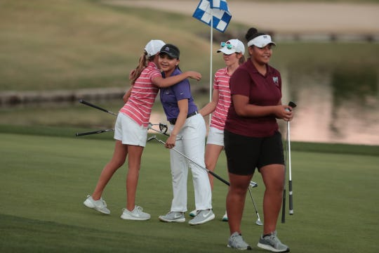 Palm Desert's Hailey Hays hugs Shadow Hills' Maleyna Gregorio as Palm Desert's Caroline Wales and Rancho Mirage's Lehapi Taungahihifo look on at the La Quinta Resort Golf Course following the DEL individual finals in La Quinta, Calif., on October 23, 2019.