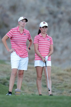 Palm Desert coach Kaitlin Ellis and golfer Danielle DeKock look out on the 17th hole of the La Quinta Resort Golf Course during the DEL finals in La Quinta, Calif., on October 23, 2019.