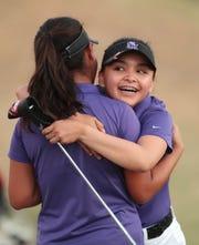 Shadow Hills' Maleyna Gregorio, right, hugs teammate Trinity Hernandez at the La Quinta Resort Golf Course after the DEL golf finals in La Quinta, Calif., on October 23, 2019.