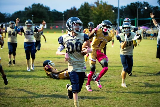 Gulf Breeze middle school student Turner Small (No. 00) scores against the A&G Rattlers. Small's touchdown was part of a secret act of kindness planned by the Rattlers and U14 Gulf Breeze Juniors.