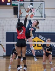Lauren Kellen (5) leaps to play the ball during the Middleburg vs Gulf Breeze FHSAA Class 5A first round volleyball tournament match at Gulf Breeze High School on Wednesday, Oct. 23, 2019.
