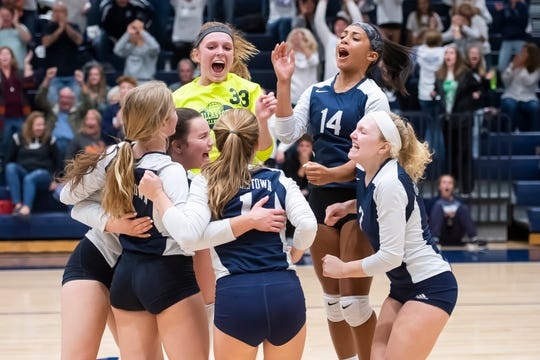 Dallastown players celebrate on the court after winning the YAIAA volleyball championship match against Central York in Dallastown on Wednesday, Oct. 23, 2019. The Wildcats won in five sets, 8-25, 25-23, 25-19, 16-25, 15-12.