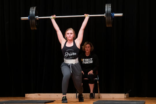 New Oxford's Mackenzie Christie demonstrates the sport of Olympic weightlifting during  a rehearsal session for the Miss Hanover Area Pageant at New Oxford High School on Monday, Oct. 21, 2019.