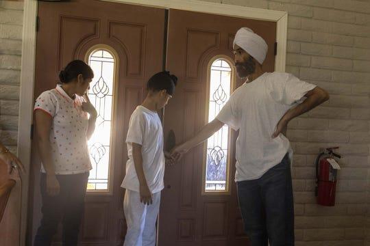 Sikh family Parmijit Kaur (left), husband Surjit Singh and their 12 year-old-son Sukhvir Singh arrive at Iglesia Cristiana El Buen Pastor Church in Mesa on Thursday, Oct. 24, 2019.