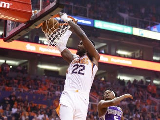 Phoenix Suns center Deandre Ayton (22) slam-dunks the ball past Sacramento Kings guard De'Aaron Fox (5) in the first half on Oct. 23, 2019 in Phoenix, Ariz.