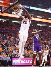 Phoenix Suns center Deandre Ayton (22) slam-dunks the ball past Sacramento Kings guard De'Aaron Fox (5) in the first half on Oct. 23, 2019 in Phoenix, Ariz.