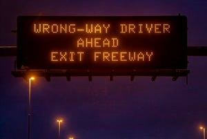 A wrong-way driver sign on the freeway.