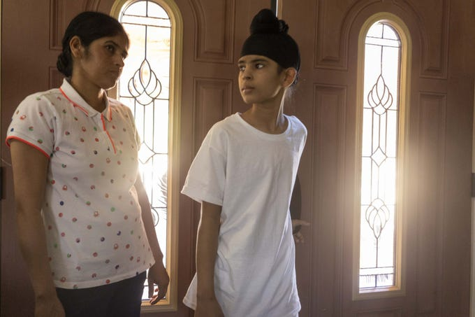Sikh family Parmijit Kaur and her 12-year-old son Sukhvir Singh arrive at Iglesia Cristiana El Buen Pastor Church in Mesa on Thursday, Oct. 24, 2019. ICE continues to release migrant families seeking asylum in the U.S. after crossing the border illegally, but the numbers are much smaller than last spring, and countries where they are from also have changed.