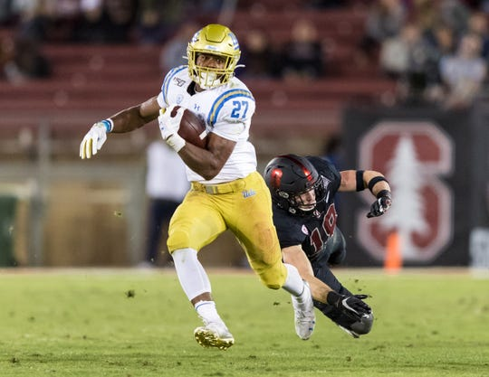 UCLA Bruins running back Joshua Kelley (27) runs the ball against the Stanford Cardinal in the fourth quarter at Stanford Stadium Oct. 17.