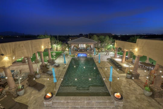 The $2.65M estate, sold by Timothy A. Ruckman, has a resort-style backyard that features a ramada and pool.