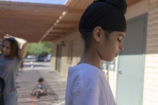 Sukhvir Singh, age 12 and part of a Sikh family from India, arrives with his parents at Iglesia Cristiana El Buen Pastor Church in Mesa on Thursday, Oct. 24, 2019.